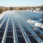 commercial solar panels across entire flat roof